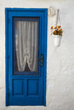Old Blue Door Of The White House. Flowerpot Hanging Stock Photography