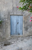 Old blue door on old facade Royalty Free Stock Photography
