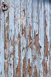 Old blue door with paint chipping off. Details of old door. Blue paint has fallen off Royalty Free Stock Image