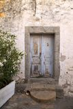 Old blue door in stone wall. Old blue wooden door in a wall stone building in Chora, Patmos, Greece Stock Image