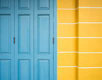 Old blue door and yellow wall Royalty Free Stock Photography