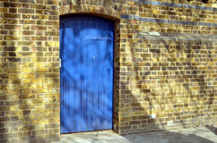 Old blue door and yellow wall Royalty Free Stock Images