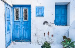 Cityscape of the island Mykonos. Old blue doors and windows in old house at island Mykonos Royalty Free Stock Photography