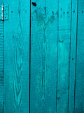 Old blue doors. Wood texture. Texture of metal. Old shabby, irradiated paint Royalty Free Stock Photography