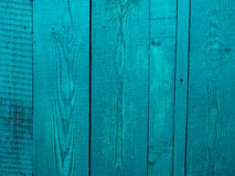 Old blue doors. Wood texture. Texture of metal. Old shabby, irradiated paint Stock Image