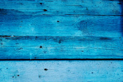 Old blue fence. Texture of old wooden fence painted in blue Royalty Free Stock Image