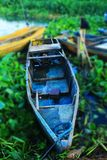 Blue fishing boat floating. Old blue fishing boat floating in the midst of water lilies laguna lake Philippines nov. 2017 Cupang Muntinlupa City Royalty Free Stock Image