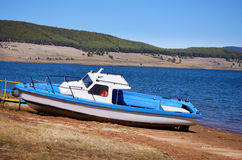 Old blue fishing boat on the lake Royalty Free Stock Image