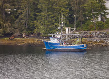 Old Blue Fishing Boat on Shore Royalty Free Stock Image