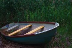 Old Metal Rowing Boat On The Background Of Reeds Stock Photos