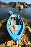 Old blue fishing wooden boat on the coast Stock Images