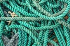 Old blue frayed ship rope. At fishing village in Nha Trang, Vietnam stock photo
