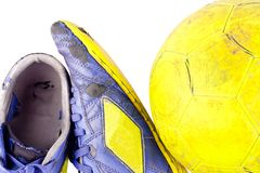 Old blue futsal shoes old yellow futsal ball on white background football object isolated