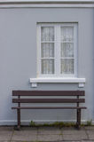 Old blue house with window and a bench. Stock Photography