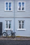 Old blue house with windows and a bicycle. Royalty Free Stock Image