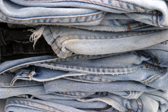 Old blue jeans. Piled upon each other royalty free stock images