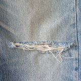Old blue jeans with torn texture Stock Photo