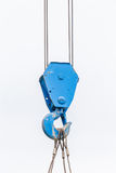 The old blue lifting crane hook is used in construction site on Stock Photos