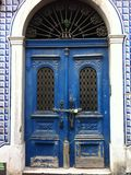 Old blue locked door. Nice old front door in a narrow alley of lisbon Royalty Free Stock Images