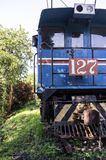 Old blue locomotive with Costa Rican flag colors. Front view of an old blue locomotive with Costa Rican flag colors. The engine is part of the Rio Grande Railway Stock Photo