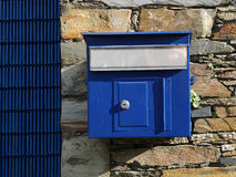 Old blue mailbox hanging Stock Photos