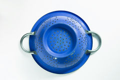 Old blue metal colander sieve  on white background Royalty Free Stock Photo