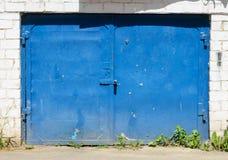 Old blue metal garage door Stock Photo