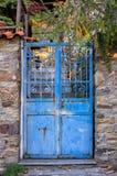 Old blue metallic gate in Parthenonas village, Chalkidiki, Greece Royalty Free Stock Images