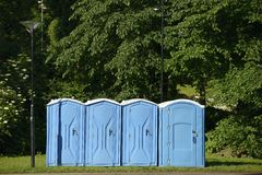 Old blue mobile toilet cabins Royalty Free Stock Image