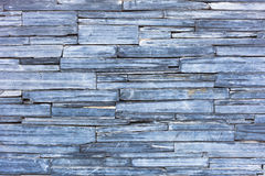 Old blue modern pattern of stone wall decorative surfaces Royalty Free Stock Images