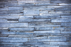 Old blue modern pattern of stone wall decorative surfaces Royalty Free Stock Photo