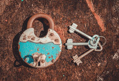 Old blue padlock and a bunch of keys Stock Photo