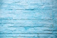 Old blue painted brick wall abstract background stock photography