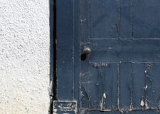 Old Blue Peeling Paint Vintage Window Shutter on White Wall Royalty Free Stock Photography