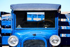 Old blue pickup truck 1920s. Front view of an american veteran car from 1920s. Blue pickup truck royalty free stock image