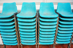 Old blue plastic chairs overlap in vertical Royalty Free Stock Image