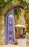 Old blue and purple wooden front door at historical house. Royalty Free Stock Image