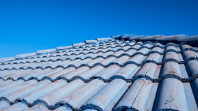 Old blue roof. The old blue roof and blue sky Stock Photos