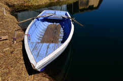 Old Blue Rowing Boat on Uros Islands Royalty Free Stock Image