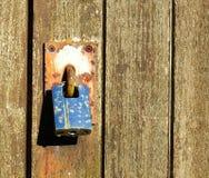 Rusty padlock on a wooden barn door Royalty Free Stock Photo