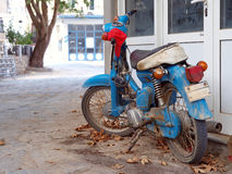 Old blue scooter. In street of village Stock Image