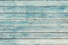 Old blue shabby wooden planks with cracked color paint. Old blue toned shabby wooden planks with cracked color paint royalty free stock photos