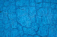 The old blue sheet of iron is covered with cracks. Abstract background. royalty free stock photos