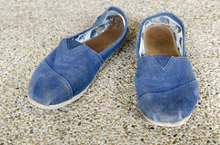 Old blue Shoes. On sand floor Royalty Free Stock Images