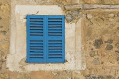 Old blue shutters Royalty Free Stock Photos