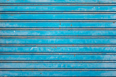 Old Blue Shutters. Old and Rusty Blue Roller Security Shutters Royalty Free Stock Photography