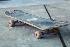 Old blue skate on gray concrete Stock Photo