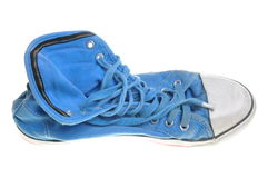 Old blue sneaker Royalty Free Stock Photo
