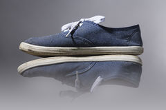 Old, blue sneakers Stock Photo