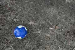 Old blue soccer ball on grass. stock photo